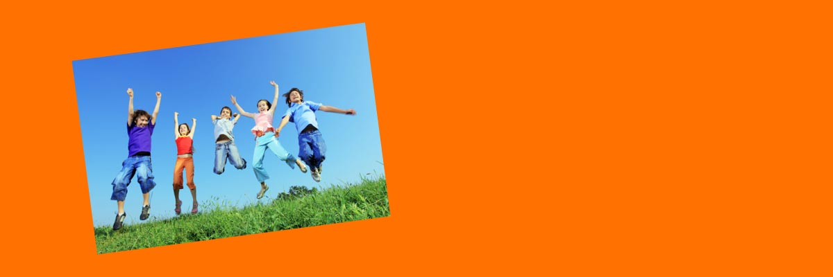 Jewelers for Children charity partners page banner showing children jumping in a field