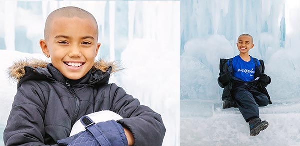 Make-A-Wish child recipient Shore sitting in front of an ice wall